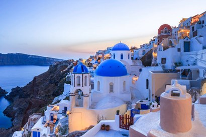 Greece, Santorini, Oia Sunset On Coastal Town by Jaynes Gallery / Danita Delimont art print