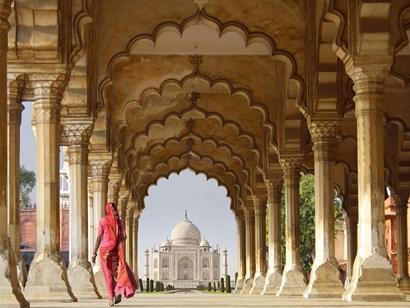 Woman in traditional Sari walking towards Taj Mahal by Pangea Images art print