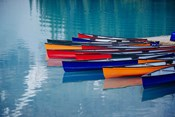 Colorful Rowboats Moored In Calm Lake, Alberta, Canada