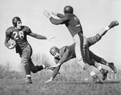 Three Men Playing Football
