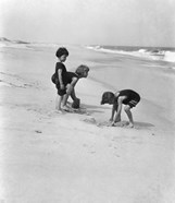 3 Kids Playing In The Sand On The New Jersey Shore