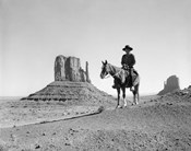 Navajo Indian In Cowboy Hat On Horseback With Monument Valley Rock Formations In Background