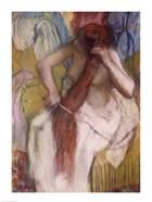 Woman Combing her Hair C