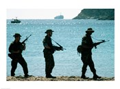 U.S. Navy Special Forces (S.E.A.L.) Team Patroling Beach