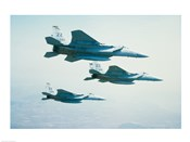 Three F-15 Eagle fighter planes flying in formation