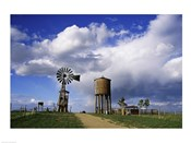 Low angle view of a water tower and an industrial windmill, 1880 Town, South Dakota, USA