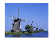Windmills along a river, Kinderdike, Amsterdam, Netherlands