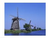 Windmills along a river, Kinderdike, Amsterdam, Netherlands