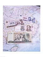 Close-up of yuan notes on a map