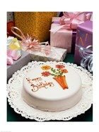 High angle view of a birthday cake with gifts