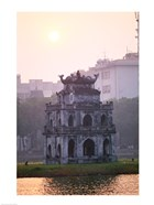 Pagoda at the water&#39;s edge during sunrise, Hoan Kiem Lake and Tortoise Pagoda, Hanoi, Vietnam