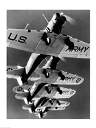 Low angle view of five fighter planes flying in formation