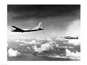 Side profile of a military tanker airplane refueling in flight, B-29 Superfortress, F-84 Thunderjet
