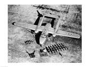 High angle view of soldiers standing near a military airplane, Fairchild C-119 Flying Boxcar