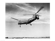 Low angle view of a military helicopter in flight, H-21D Helicopter, US Military
