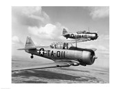 Side profile of two fighter planes in flight, AT-6 Texan