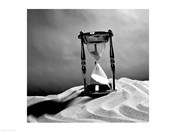Close up of hourglass on sand