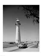 USA, Mississippi, Biloxi, Biloxi Lighthouse with street in the foreground