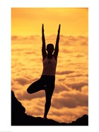 Silhouette of a young woman practicing yoga, Maui, Hawaii