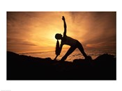 Silhouette of a young woman practicing yoga, Haleakala, Maui, Hawaii, USA