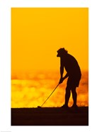 Silhouette of a man playing golf, Maui, Hawaii, USA