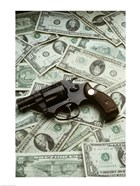 Close-up of a handgun with paper currency