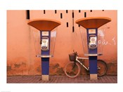 Public telephone booths in front of a wall, Morocco