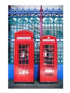 Two telephone booths near a grille, London, England