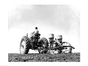 Low Angle View of a Farmer Planting Corn with a Tractor in a Field