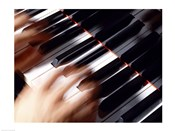 Close-up of a person's hands playing a piano