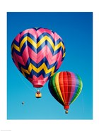 Hot Pink and Navy Blue Air Balloon Floating in the Sky