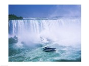 High angle view of a tourboat in front of a waterfall, Niagara Falls, Ontario, Canada