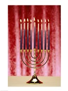 Close-up Of Lit Candles On A Menorah On Red