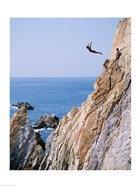 Male cliff diver jumping off a cliff, La Quebrada, Acapulco, Mexico