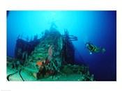 Scuba diver watching a shipwreck underwater