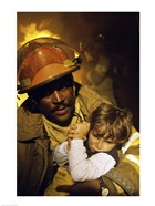 Firefighter carrying a boy