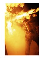 Fireman fighting with fire flames
