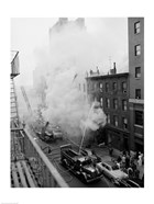 New York City, Fire on East 47th Street, with fire engines shooting water on burning building