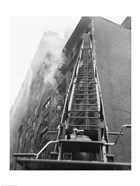 Fire engine with ladder up burning building