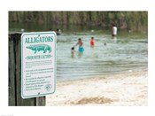Alligators warning sign at the lakeside, Florida, USA
