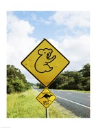 Close-up of animal crossing sign on a roadside, Australia