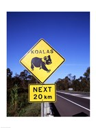 Close-up of a crossing sign on the road side, Australia