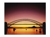 Silhouette of a bridge across a harbor, Sydney Harbor Bridge, Sydney, New South Wales, Australia