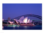 Opera house lit up at dusk, Sydney Opera House, Sydney Harbor Bridge, Sydney, Australia