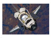 The Space Shuttle Discovery approaches the International Space Station