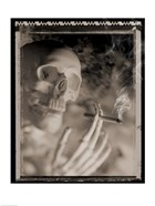 Side profile of a skeleton holding a cigarette