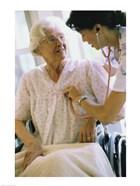 Female nurse checking a female patient's heartbeat