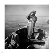 Hauling in a cod aboard a Portuguese fishing dory off Cape Cod, Massachusetts