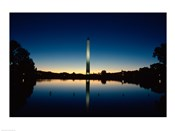 Reflection of an obelisk on water, Washington Monument, Washington DC, USA
