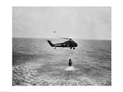 Marine helicopter lifting the astronaut spacecraft out of the Ocean